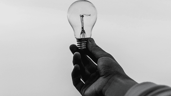 hand holding a light bulb - black and white image